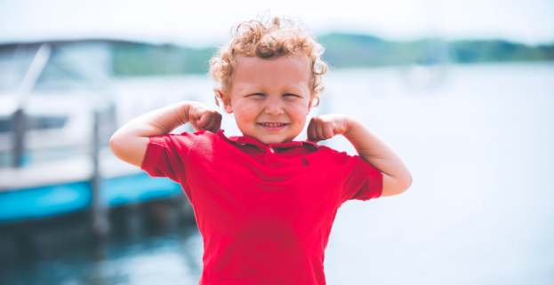 kid flexing muscles